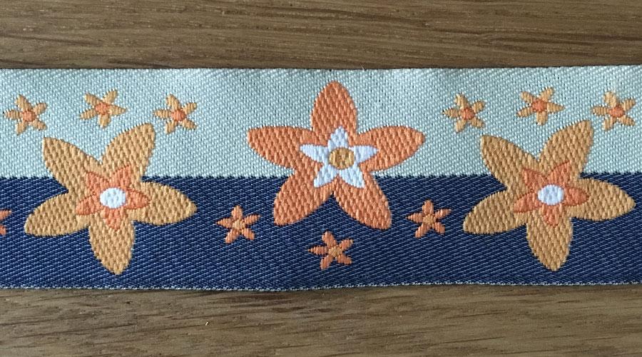 Ajani - beige-grau mit orangenen Sternen